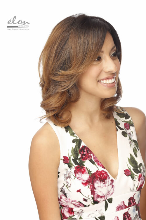medium-layered-hairstyle-with-soft-curls-side