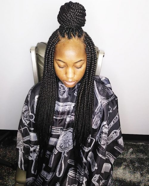 Senegalese twists on a top knot bun