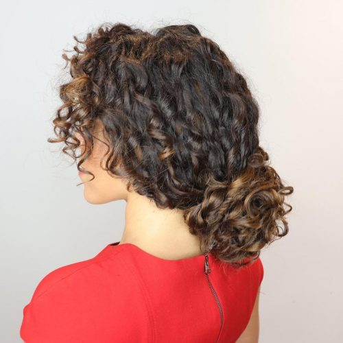 A fabulous curly ponytail with bangs