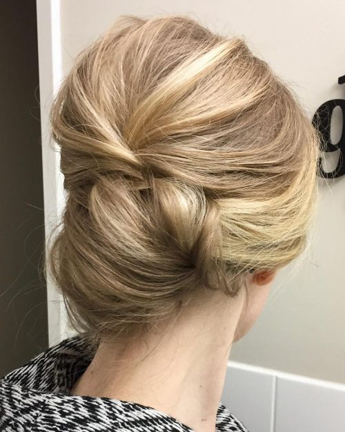 Picture of a romantic low bun formal simple updo