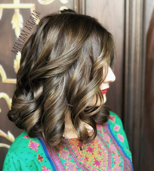 Picture of an adorable ash brown shoulder length curls