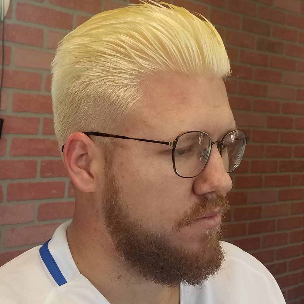 An adventurous slicked back yellow blonde hair color