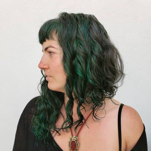 curly asymmetrical long bob with bangs