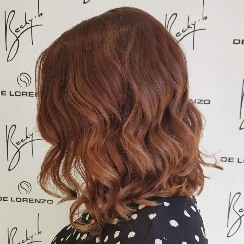 Picture of an attractive auburn shoulder length hair color