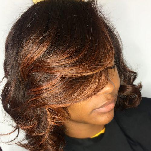 Auburn hair on dark skin