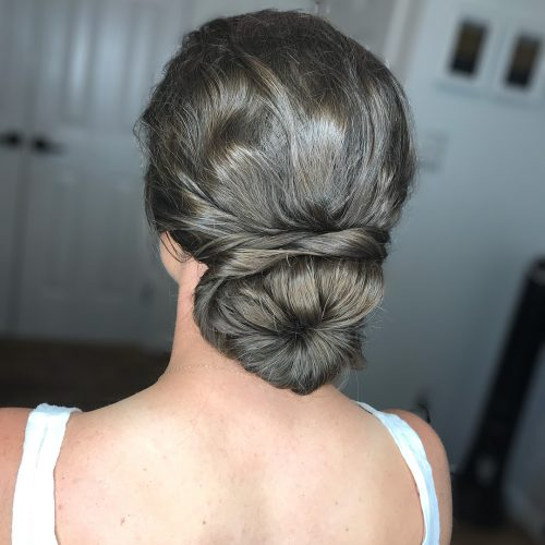 Picture of a beautiful elegance with a modern spin evening hairstyle