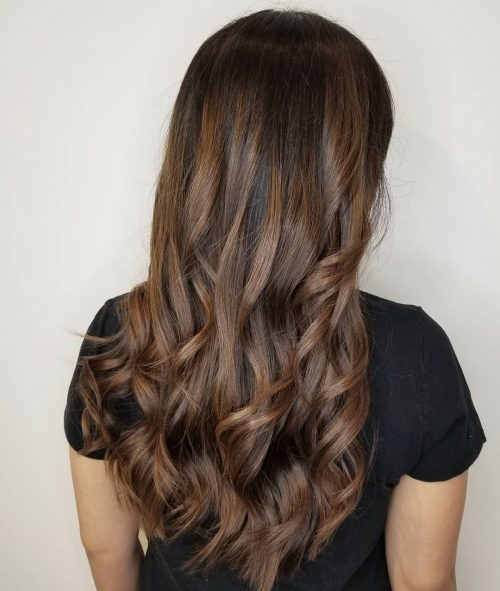 Picture of a beautiful long loose curls on caramel brown