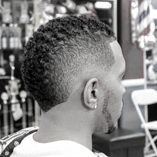 Picture of a black mens burst fade mohawk haircut