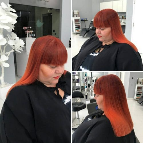 Blazing red copper hair color with bangs