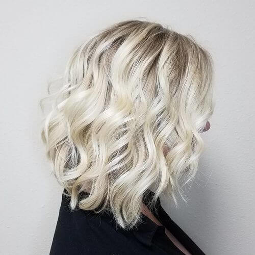 A wavy bob platinum blonde with babylights
