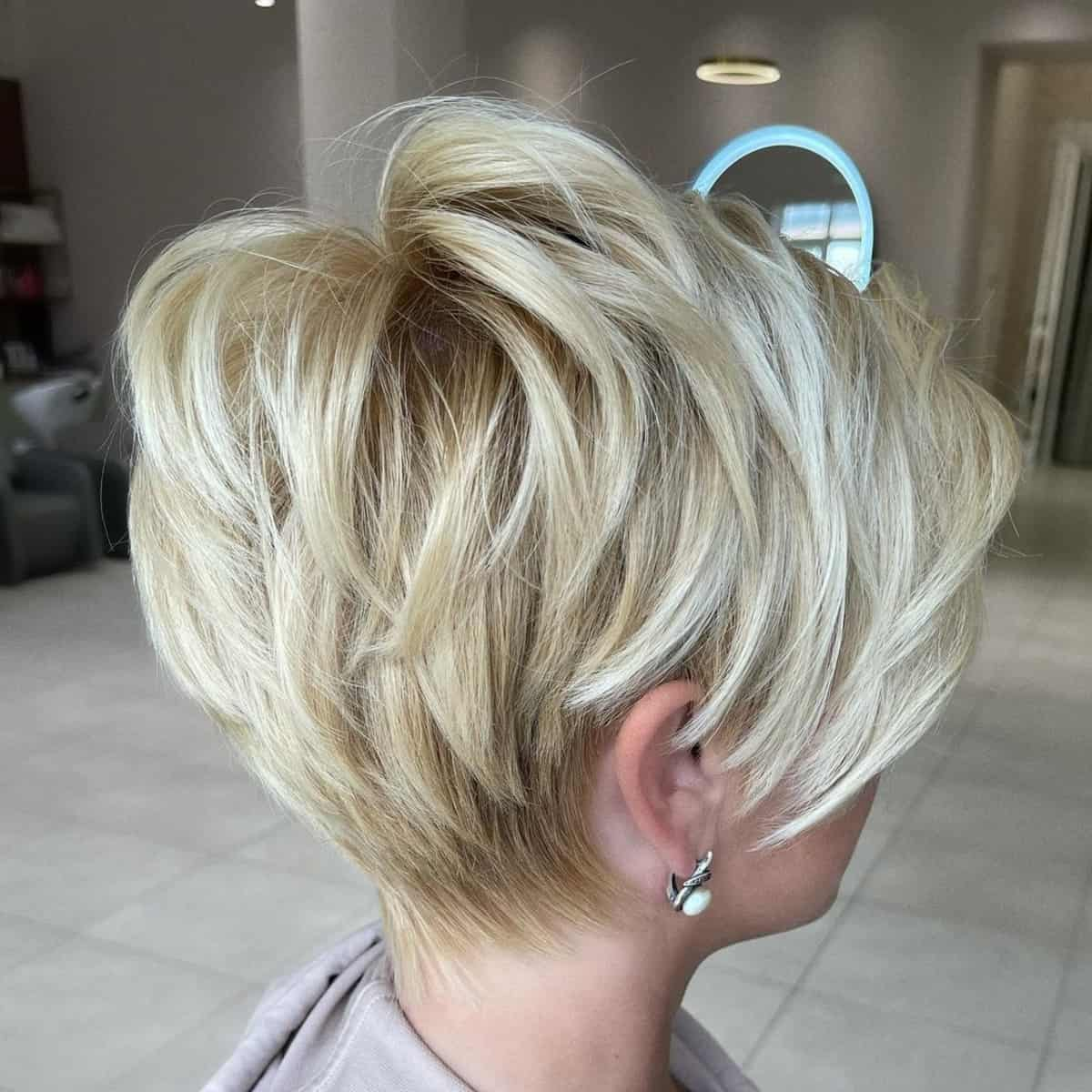 Blonde layered long pixie cut