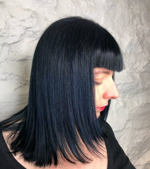 Picture of blunt bangs and textured ends blue black hair