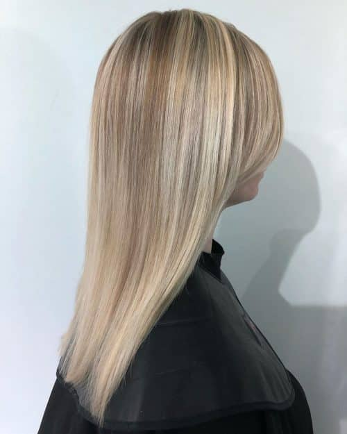 blunt cut long hair with side bangs