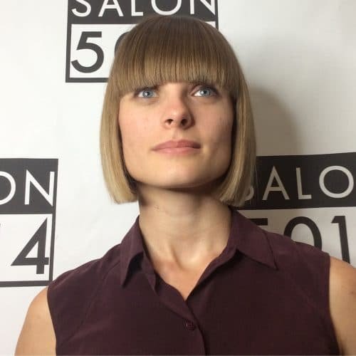 A delightful one length short blunt bob with heavy bangs