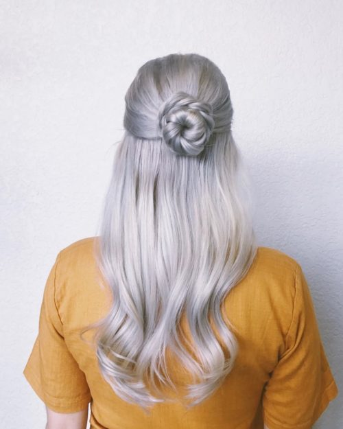 Picture of a braid wrapped twist long hairstyle for wedding