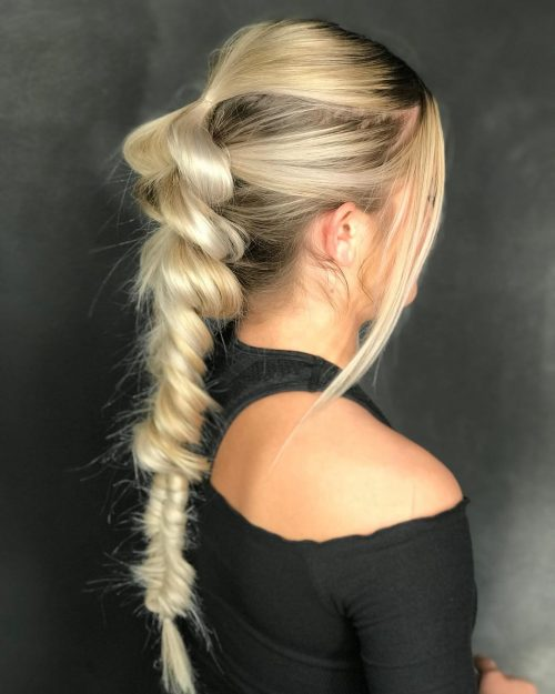 Picture of a bright blonde pull though braided prom updo for long hair