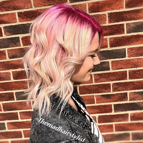 Picture of a bright pink rooted shoulder length ombre