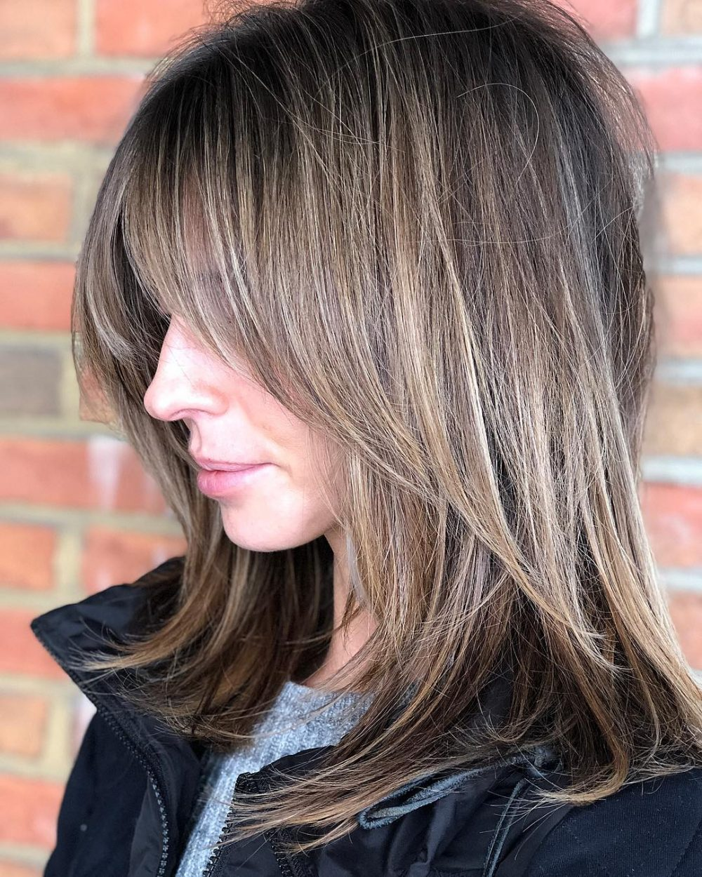 A trendy bronde colored shag with bangs
