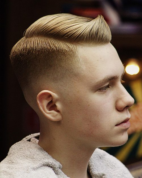 Picture of a short men's brushed up hair