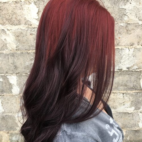 A picture of a burgundy ombre hair color
