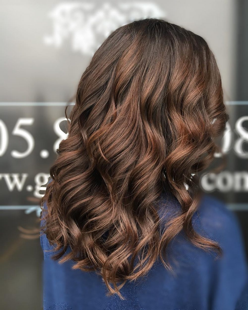 Brown Dark hair with caramel lowlights forecasting to wear for spring in 2019