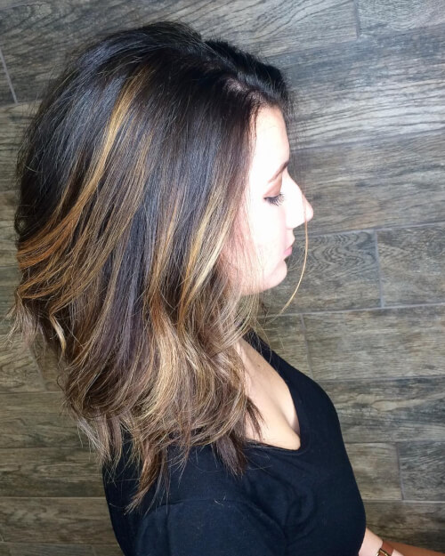 Magnificent shoulder length dark hair with highlights