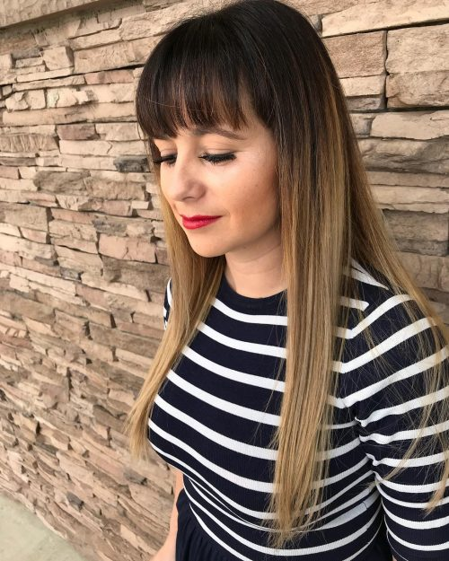 Picture of a chic long ash blonde ombre with long bangs