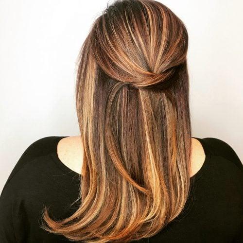 Cinnamon red hair with streaks of honey