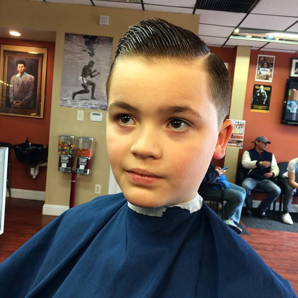 A tapered haircut with a hard part haircut for little boys