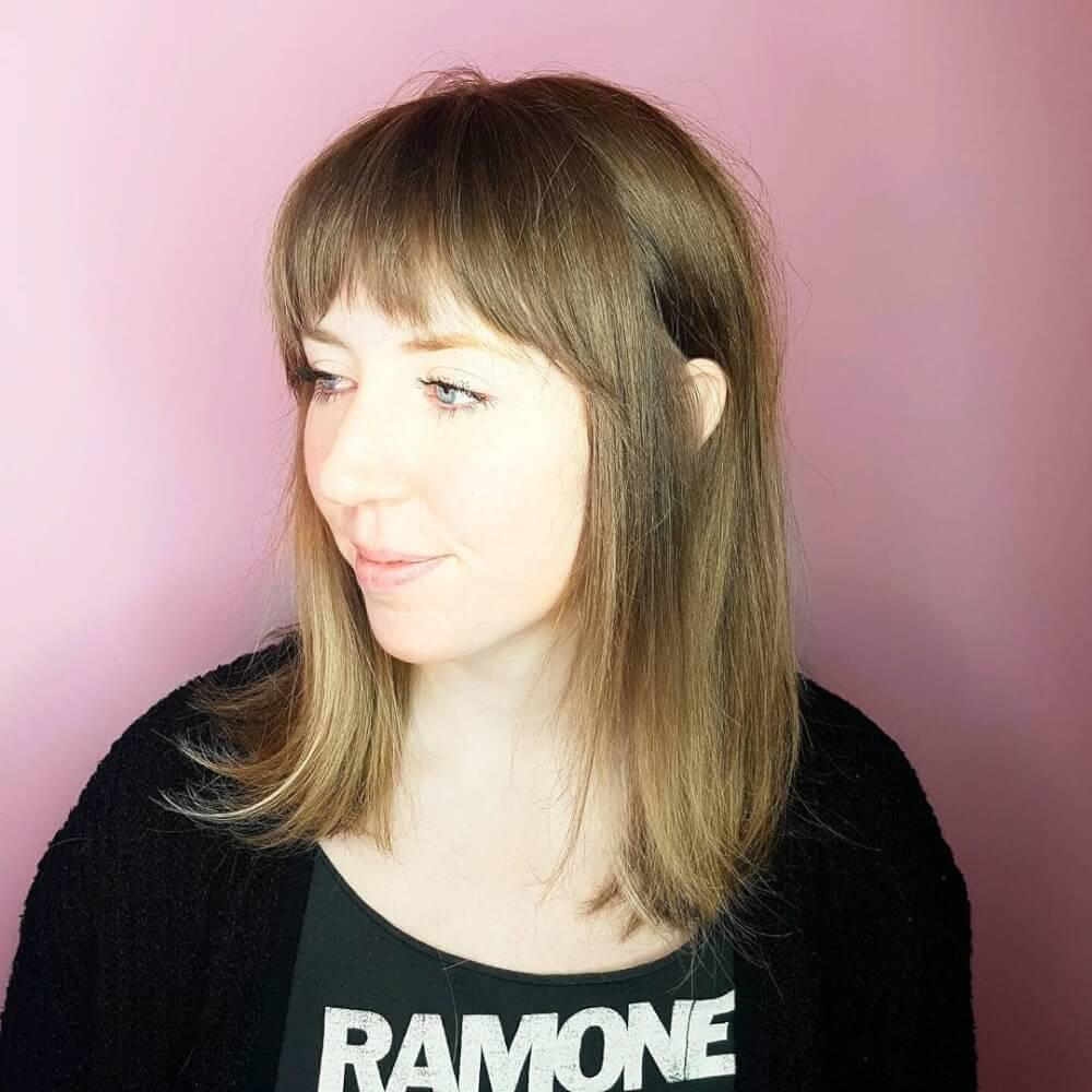 A noteworthy straight hairstyle with a shoulder length cut and bangs