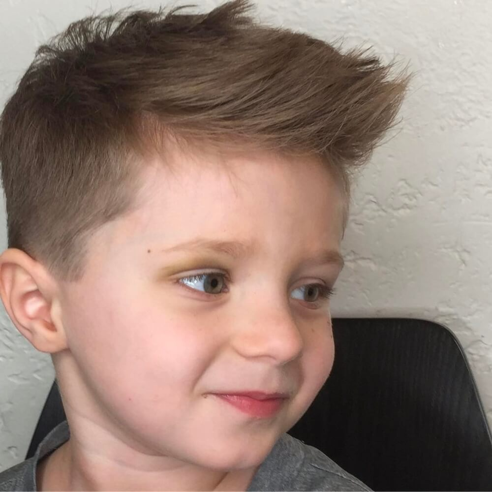 A brushed forward and textured haircut for toddler boys
