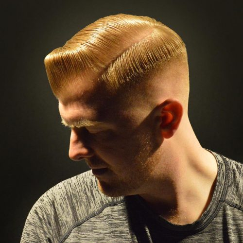Comb over blonde hair with taper fade