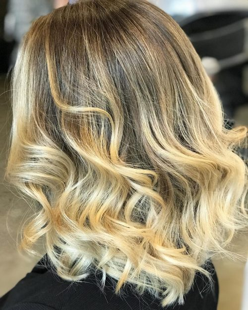 Curled hair with blonde balayage color
