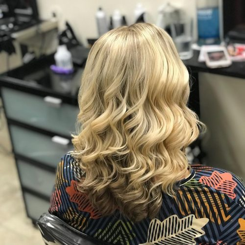 curled hair with blonde all over