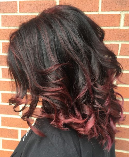 Curled hairstyle with 180 asymmetrical cut