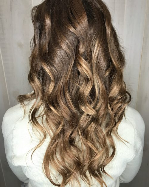 Women with long hair thats curled with lowlights