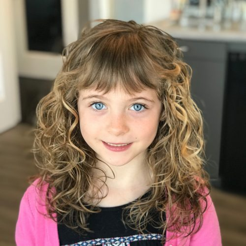 Picture of curly cut with bangs for girls with curly hair