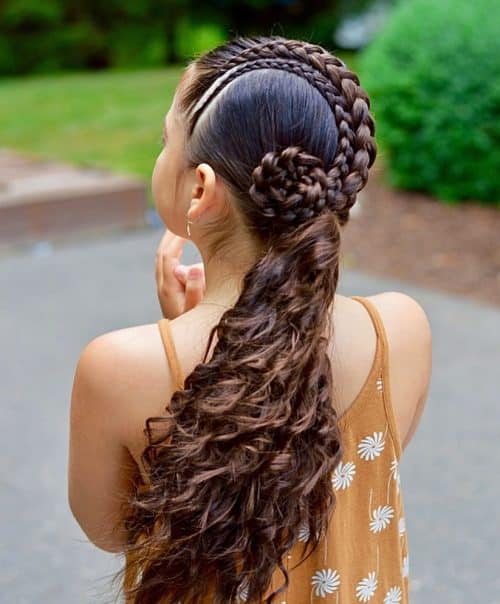 curly hair braided low for homecoming