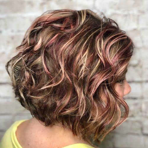 Curly Light Brown Hair with Auburn Highlights