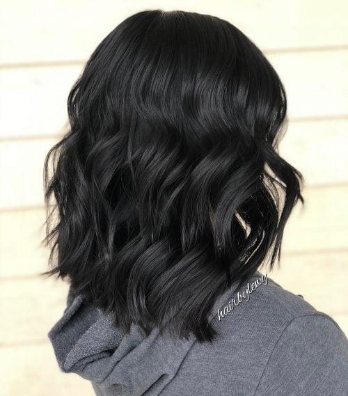 A medium layered wavy bob haircut