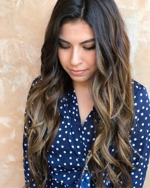 A dark brunette balayage hair color
