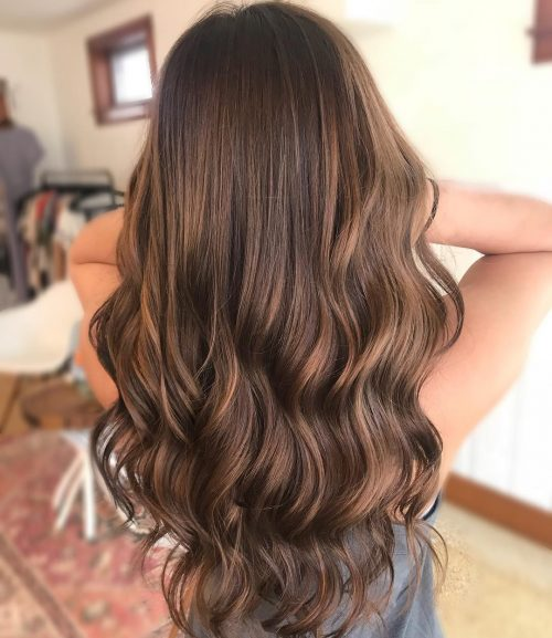 Picture of a dashing long caramel brown balayage for olive skin