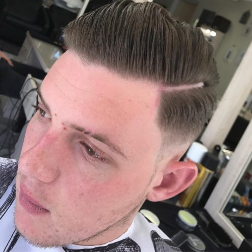 Pompadour with a deep line part