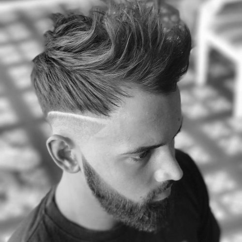 A very low disconnected undercut with a razor part