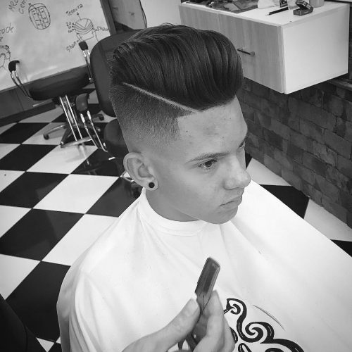 Picture of a disconnected undercut for long straight hair with a pomp