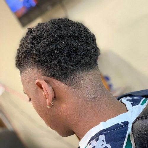 Afro Fohawk Dope con lados afeitados para hombres negros