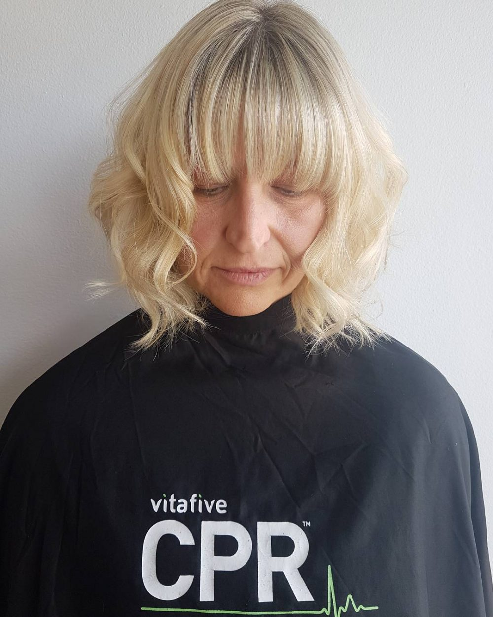 Effortless Bob with Bangs and Blonde Hair