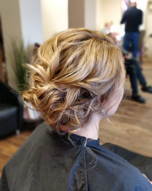 Picture of an effortlessly pinned messy updo