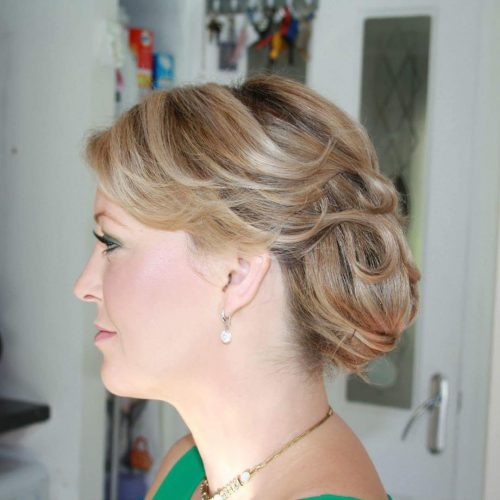 Elegant Side Bun With Movement hairstyle
