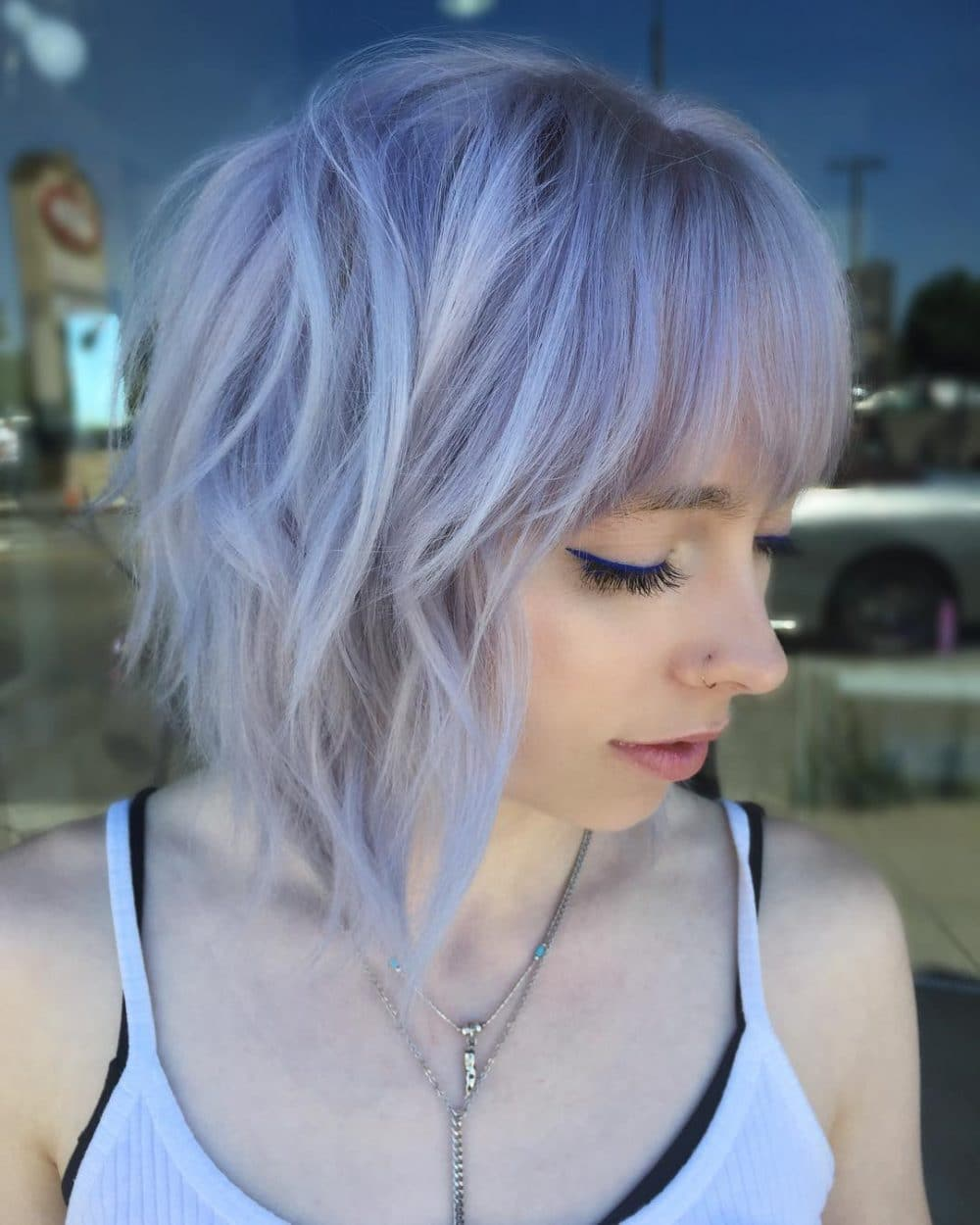 A disheveled purple shag haircut for short hair
